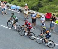 Tres ciclistas Imagen de archivo libre de regalías