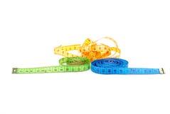 Tres cintas de medición de diversos colores Imagen de archivo libre de regalías