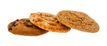 Tres clases de diversas galletas en blanco aislaron el fondo Foto de archivo libre de regalías