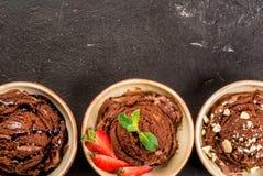Tres clases de helado de chocolate Imagenes de archivo