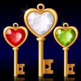 Tres claves de oro con el corazón de la joya Imágenes de archivo libres de regalías