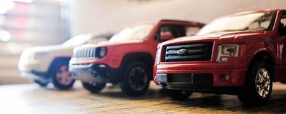 Tres coches del juguete fotografía de archivo