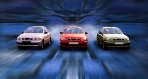 Tres coches en la velocidad en noche Imágenes de archivo libres de regalías