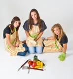 Tres cocineros adolescentes Foto de archivo libre de regalías