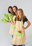 Tres cocineros de sexo femenino Fotografía de archivo