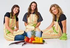 Tres cocineros de sexo femenino Imagen de archivo libre de regalías