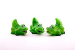 Tres cocodrilos o cocodrilos curiosos del juguete Imágenes de archivo libres de regalías