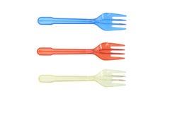 Tres colorearon forkes plásticas aisladas en blanco Imagen de archivo libre de regalías