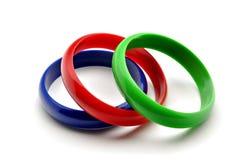 Tres colores de las pulseras Fotos de archivo