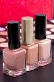 Tres colores desnudos agradables en botellas - componga los accesorios Imágenes de archivo libres de regalías