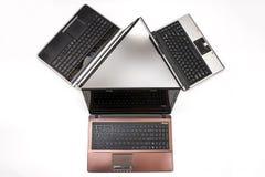 Tres computadoras portátiles Fotos de archivo libres de regalías