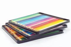 Tres conjuntos de lápices del color en caso de lápiz Fotografía de archivo