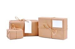 Tres conjuntos marrones con las escrituras de la etiqueta en blanco Fotos de archivo libres de regalías