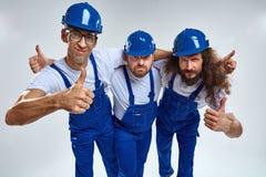 Tres constructores divertidos - retrato aislado fotografía de archivo libre de regalías