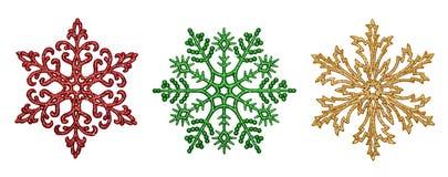 Tres copos de nieve decorativos Imágenes de archivo libres de regalías
