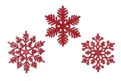 Tres copos de nieve rojos del brillo Imágenes de archivo libres de regalías