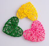 Tres corazones coloridos que forman una forma imagen de archivo