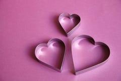 Tres corazones de plata Fotografía de archivo libre de regalías