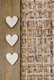 Tres corazones en la madera Foto de archivo libre de regalías
