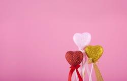 Tres corazones junto en rosa foto de archivo libre de regalías