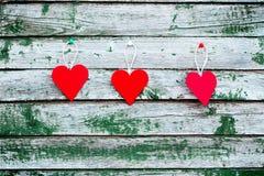 Tres corazones rojos Imágenes de archivo libres de regalías
