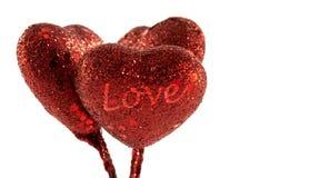 Tres corazones rojos de la decoración Fotos de archivo libres de regalías
