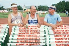 Tres corredores en las Olimpiadas mayores Fotografía de archivo