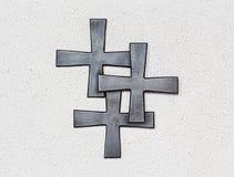 Tres cruces en la pared fotografía de archivo