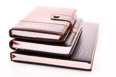 Tres cuadernos aislados Fotos de archivo