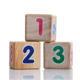 Tres cubos con los dígitos 123 Imágenes de archivo libres de regalías