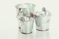 Tres cubos del metal Fotografía de archivo libre de regalías