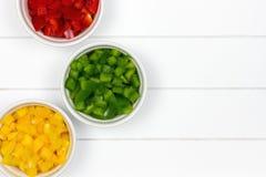 Tres cuencos con paprikas coloridas Foto de archivo libre de regalías