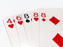 Tres de la tarjeta buena en juego de póker con el fondo blanco Fotografía de archivo