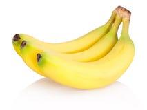 Tres de plátanos maduros aislados en el fondo blanco Imagen de archivo libre de regalías