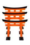Tres de Torii anaranjado en el fondo blanco, aislado Foto de archivo libre de regalías