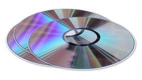 Tres discos del CD/DVD aislados en blanco Fotografía de archivo