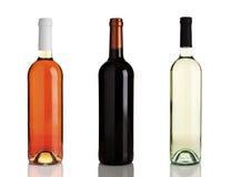 Tres diversas botellas de vino sin escrituras de la etiqueta Imágenes de archivo libres de regalías
