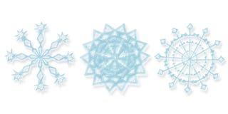 Tres diversos copos de nieve Foto de archivo