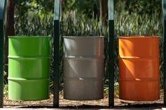Tres diversos cubos de la basura en un parque público fotos de archivo libres de regalías