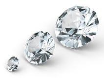 Tres diversos diamantes en el fondo blanco Foto de archivo libre de regalías