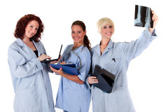 Tres doctores de sexo femenino atractivos fotos de archivo