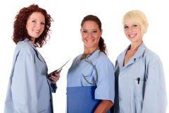 Tres doctores de sexo femenino atractivos fotos de archivo libres de regalías