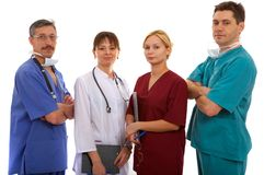 Tres doctores y enfermera Fotos de archivo libres de regalías