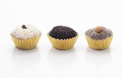 Tres dulces brasileños - Beijinho, Brigadeiro y Cajuzinho Foto de archivo libre de regalías