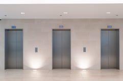 Tres elevadores Fotografía de archivo