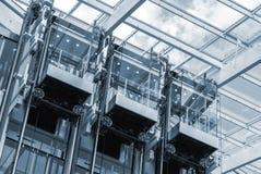 Tres elevadores en un centro de negocios Fotografía de archivo