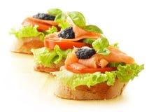 Tres emparedados con los salmones y el caviar Fotos de archivo libres de regalías