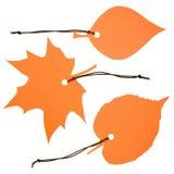 Tres escrituras de la etiqueta foliformes anaranjadas Fotografía de archivo