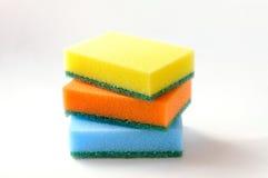 Tres esponjas coloreadas Fotos de archivo libres de regalías