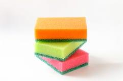 Tres esponjas coloreadas Foto de archivo